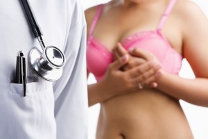 Doctor and woman on pink bra