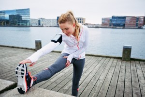 Female runner stretching before a run